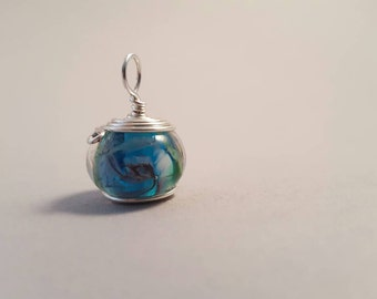 Lampwork blue encased spiral Wire Wrapped pendant