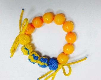 Seed beaded blue and orange braselet with suede elements