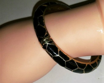 Vintage unsigned hinged Bangle with Black and Gold Enamel Snake Pattern