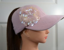 Baseball cap in pink woolwith a sequin flower  has a high opening for a ponytail without the need for barrettes or holders
