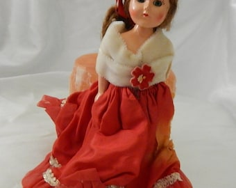 Corrine's Dolls of All Nations Spain Wearing Red Dress White Shawl. Use Coupon Code CDT25OFF for 25% Off!