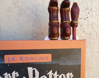 Harry Potter bookmark with broomsticks Quidditch legs of Harry Potter sticking out from book, best bookmark for best Harry Potter book