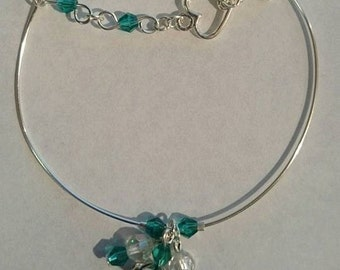 Silver plated bangle with green crystal detail