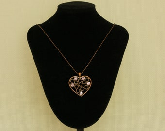 Bronze heart pendant necklace with crystal glass.