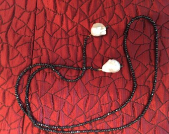 Front knot lariat type necklace with black spinel and baroque pearls