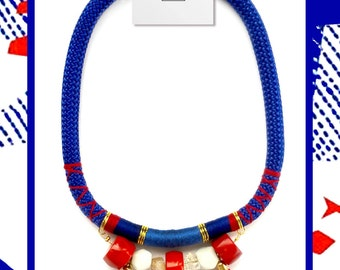 Blue rope necklace with red and white stones