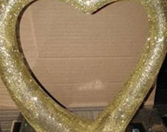 gold glittered heart sculpture