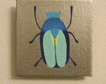 Blue Insect with Silver Metallic Background