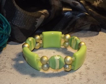 Bracelet of glass beads and acrylic beads on elastic, lime green