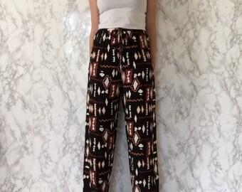 CLEARANCE...80s navajo aztec print pants | wide leg rayon pants