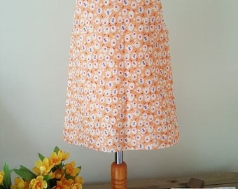 Girl's cotton, fully lined, sleeveless dress, tunic or blouse.  Size 6 - 12months. Orange with  flowers, polka dot lining