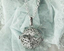 Tree round locket pendant on a necklace with tree motif silver fashion jewelry