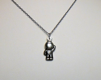 Little silver astronaut pendant