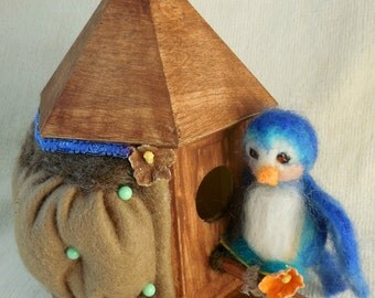 The blue bird of happiness felted  wool pincushion will remind you  of blessings that are all around the every day  places. l