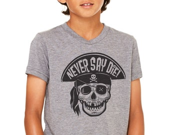 Never Say Die: Youth Unisex Blend Soft Blend T