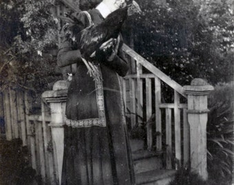 vintage photo 1914 Woman Outside Rose Covered Porch Holds Pet Rooster