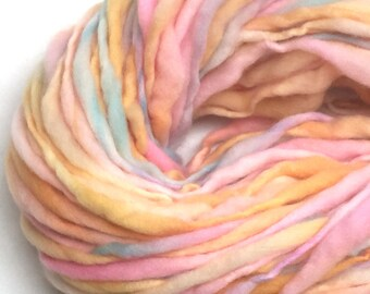 Handspun chunky yarn, 50 yards and 1.5 ounces/42 grams spun thick and thin in hand dyed merino wool