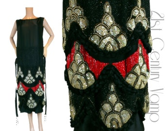 1920s Flapper Dress. 20s heavy beaded pattern in red, silver, black and iridescent gold. Original Vintage Art Deco design.