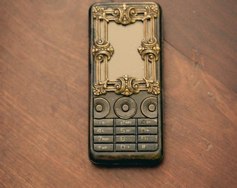 Steampunk phone - based on Sony ericsson ,with charger and camera, steam technology functional