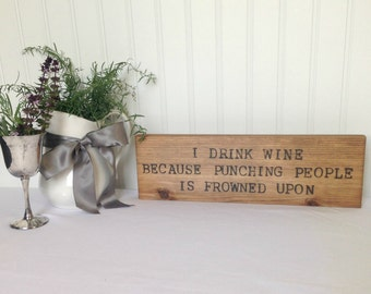 I drink wine because... -  Wood Sign Burned Quote