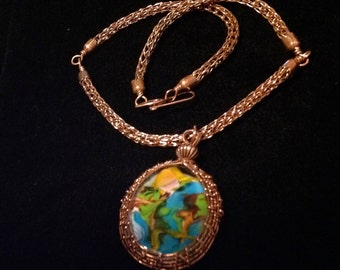 This is a beautiful large blown glass pendant. everyone sees different pictures in it. viking knit chain
