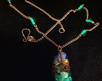 Blown glass pendent ocean inspired wrapped in copper