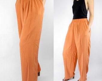 HOLIDAY SALE 1980's deadstock orange silk palazzo pants / vintage I. Magnin Design Studio pants / flowy silk harem pants / size large