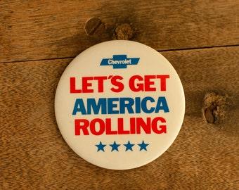 Vintage CHEVROLET Pinback Button - Let's Get America Rolling