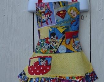 Little Girl Super Hero Apron, Wonder Woman, Super Girl and Bat Girl all Grace this Apron