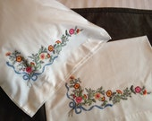 Hand embroidered Jacobean floral design pair of pillowcases -- Floral and blue ribbon design -- lovely for your bed!