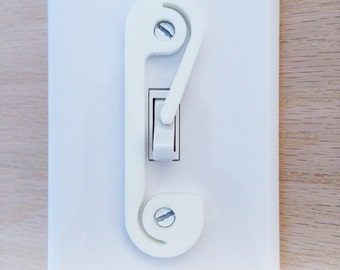 Light switch lock; childproof safety garbage disposal