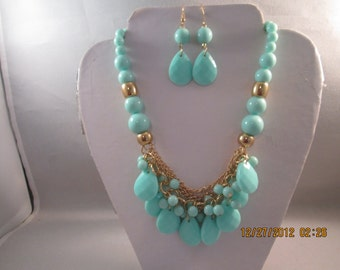 4 Row Bib Necklace with Turquoise Color Beads and Gold Tone Chains with Matching Earrings