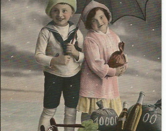 Antique Art Photograph Christmas Postcard Little Girl & Boy with Umbrella in Snow