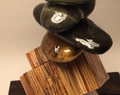 Zen stack of sea stones on engineered lumber