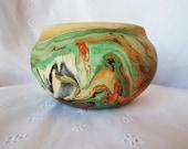 Nemadji Pottery Green Orange and Black Swirl Bowl