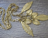 Botanical Leaf Necklace. Gold Plate Metal Pendant Charm Necklace. Vintage Early 1980's Age. Chain Link 36 Inch Chain, 7 Leaves. Dipped GOLD