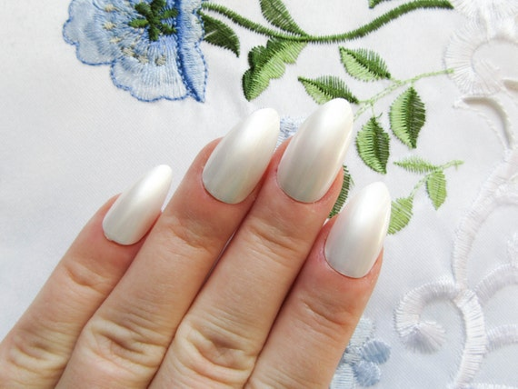 how to take press on nails off