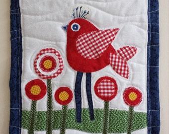 Red gingham bird in garden
