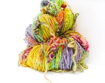 232 yards 6.4 oz of super soft handspun single yarn with sparkle nylon super wash merino and suri alpaca locks. Worsted - Bulky thick & thin