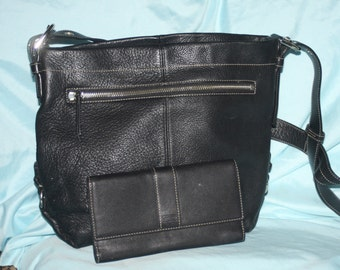 On sale see shop for details Authentic Coach Black Pebbled Leather. Coach wallet included.