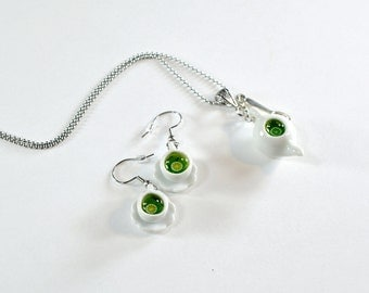 Greedy jewelry, teapots and cups with green tea, cups and miniature teapot porcelain, necklace and earrings, sweet jewel