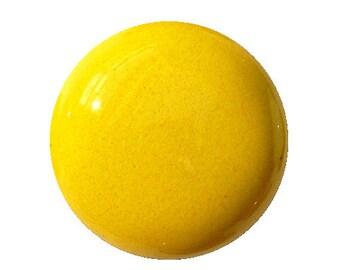 Yellow enameled ceramic button. Closer clip.