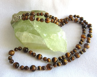 Necklace tigereye gemstone 4mm and 6mm brown tigereye with sterling silver accent beads anc clasp.  Length 20 inches, nice banding.