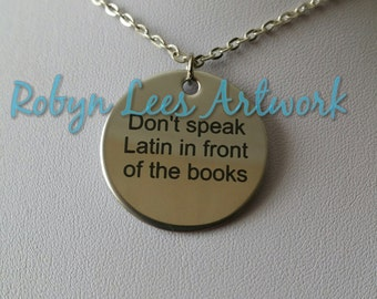 Stainless Steel Engraved Don't Speak Latin In Front Of The Books Word Disc Necklace on Silver Crossed Chain