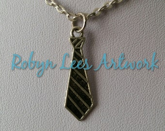 Small Silver Tie Charm Necklace on Silver Crossed Chain or Black Faux Suede Cord, Fashion