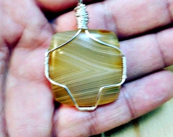 Botswana agate wire wrapped pendant necklace on sterling silver-botswana agate necklaces-agate necklaces-botswana agate jewelry-yellow stone