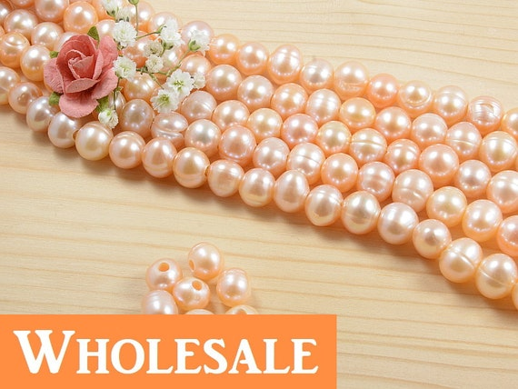 WHOLESALE 8mm - 9mm, genuine freshwater pearls , large 2.5mm hole, natural round, natural pink/ peach color - 40+ PCS per strand