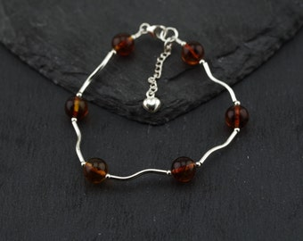 Real Amber minimalist bracelet, curved sterling silver tubes, sterling silver findings. Friendship bracelet. Made in Scotland by Lys & Rose