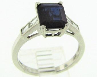 14k White Gold Emerald cut Sapphire ring.