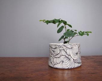 Cache pot planter pottery white with black design black and white